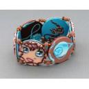 bracelet perles plates réversible fond turquoise fleur marron / visage fleur marron