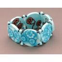 bracelet perles plates réversible fond turquoise clair fleur marron /  transparent turquoise